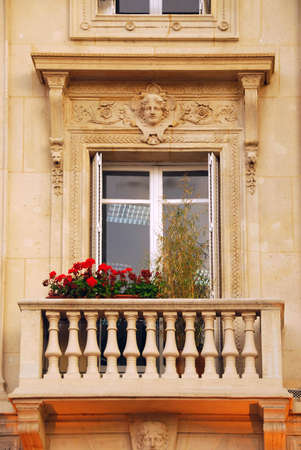 plaster of paris: Old window with balcony and flower boxes in Paris France Stock Photo