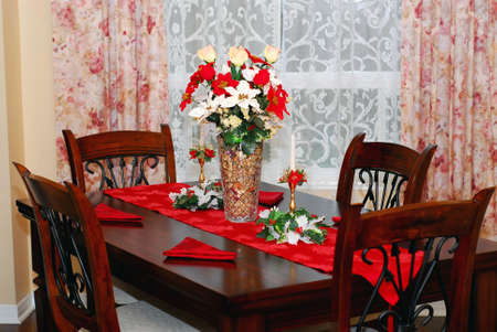 Dining room decorated for Christmas celebration photo
