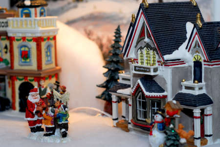 Toy Chrismas village with figurines and houses Stock Photo