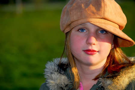 suede: Portrait of a young girl wearing suede hat on green background