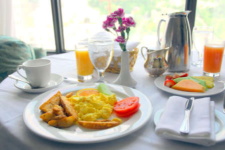 Breakfast for two served in a hotel room photo