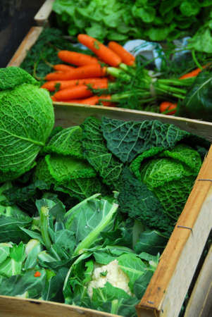 Fresh assorted vegetables in boxes on farmer's market Stock Photo - 671780