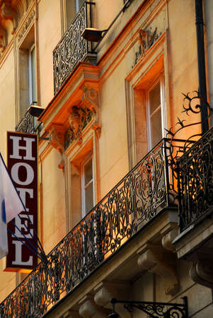 Hotel building in Paris France with wrought iron balconies photo