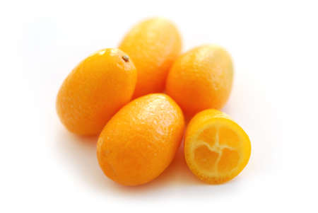 asian produce: Fresh ripe kumquats isolated on white background