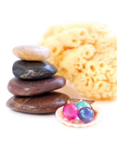 Stack of balanced stones with bath beads isolated on white background photo