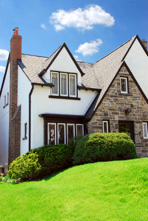 Residential tudor style house with blue sky in background Stock Photo - 733890