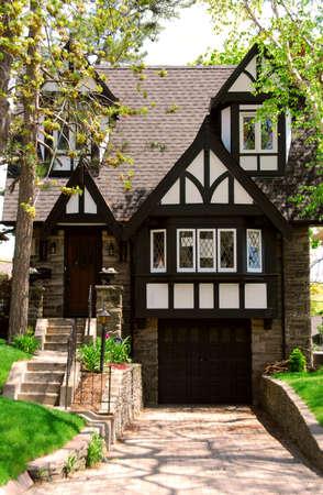 tudor: Residential tudor style house with green trees