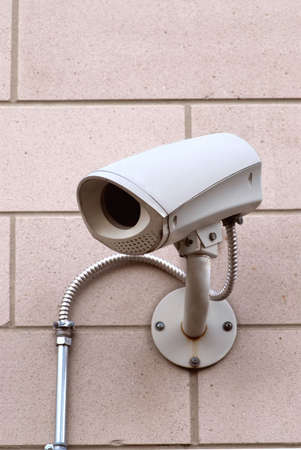 close circuit camera: Security video camera on outside wall of a building