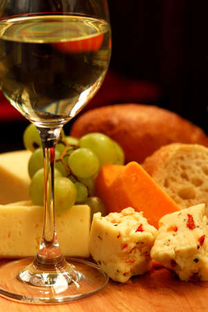 entre: Glass of white wine and assorted cheeses for wine tasting