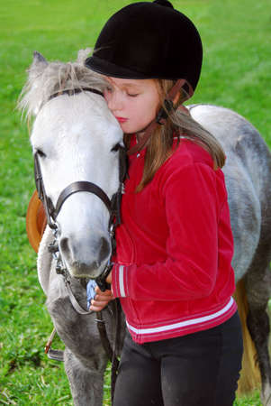 pony girl: Young girl with a white pony at countryside