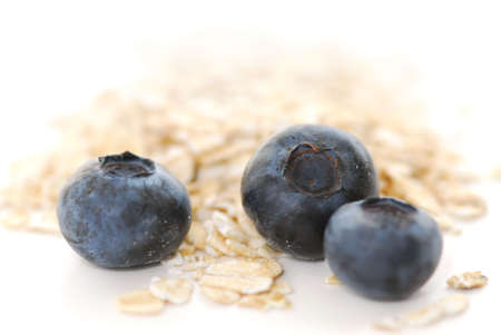 Blueberries and oats macro on white background