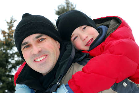 Portrait of father and son playing in winter park Stock Photo - 753911