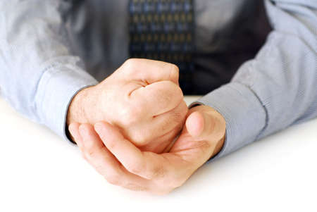 Closeup of businessmans hands on white background making a fist Stock Photo