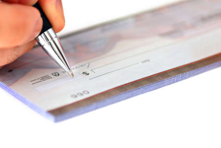 Closeup of man's hand writing a cheque Stock Photo - 778024