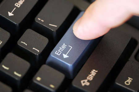 Macro of computer keyboard with finger pressing