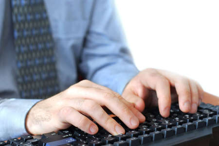 Closeup of mans hands typing on a keyboard photo