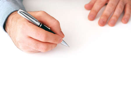 Closeup of businessmans hands on white background holding a pen