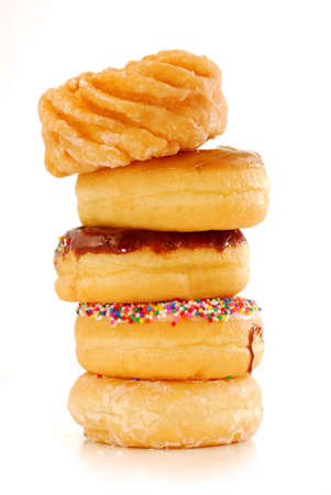 Tower of assorted donuts isolated on white background photo