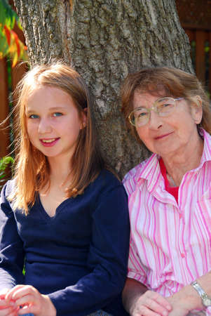 Family generations - portrait of granddaugher and grandmother