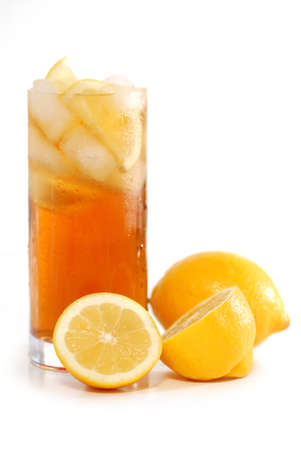 Glass of lemon cold iced tea with lemons on white background photo