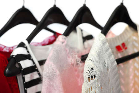 Women's clothing on a rack, white background