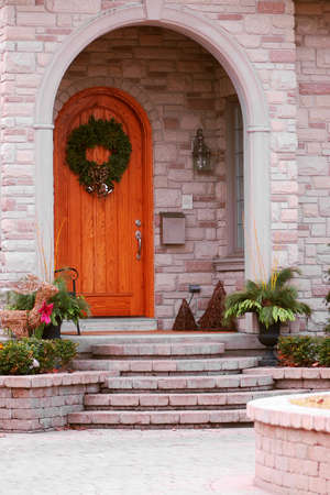 Entrance of a luxury house with natural stone landscaping Stock Photo