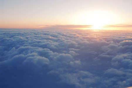 Spectacular view of a sunset above the clouds from airplane window Stock Photo - 954992