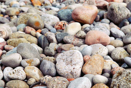 Background of colofrul beach pebbles of different shape and size photo
