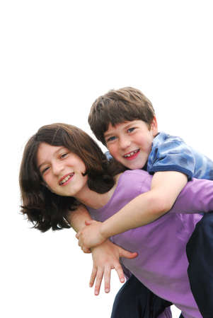 Portrait of children brother and sister playing isolated on white background photo