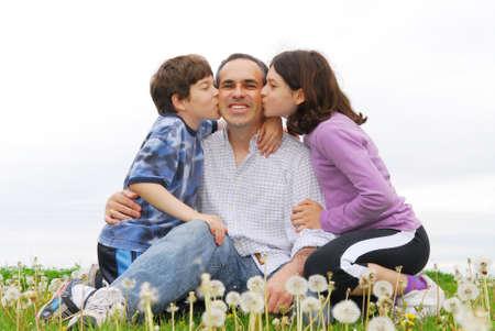Grateful children giving their father a kiss