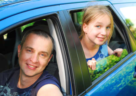 go inside: Father and daughter sitting inside the car ready to go on family trip Stock Photo