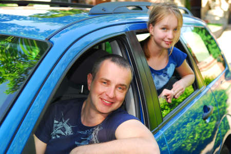 Father and daughter sitting inside the car ready to go on family trip Stock Photo