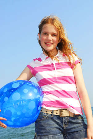 beach ball girl: Portrait of a young beautiful girl on sea shore with beach ball