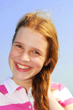 breezy: Portrait of a beautiful young girl on a breezy day outside