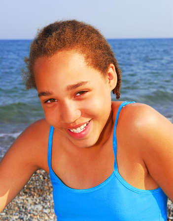 Portrait of a young beautiful girl on sea shore