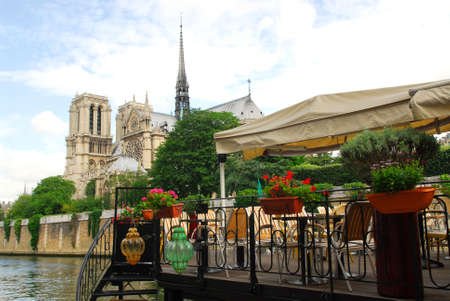 Restaurant on a boat on river Seine with the view of Notre Dame de Paris Cathedral in Paris France Stock Photo - 1305175