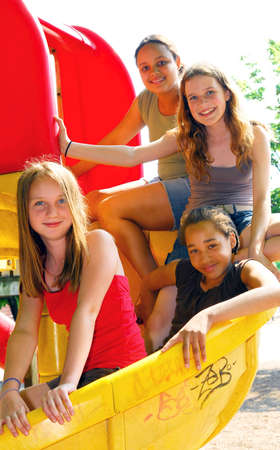 school playground: Portrait of a group of four young girls on a school playground