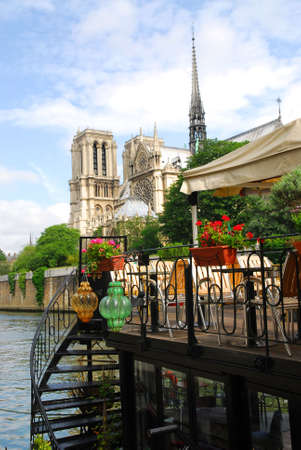 Restaurant on a boat on river Seine with the view of Notre Dame de Paris Cathedral in Paris France Stock Photo - 1327215