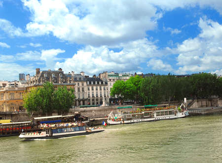 Tourist cruise boats on river Seine in Paris, France. Stock Photo - 1327226