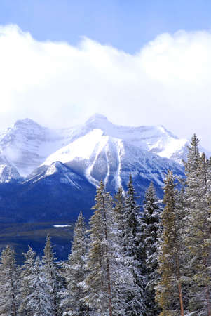 Snowy mountain ridges at Lake Louise in Canadian Rocky mountains photo