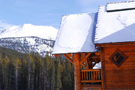 Log cabin in Canadian Rocky mountains at Lake Louse photo