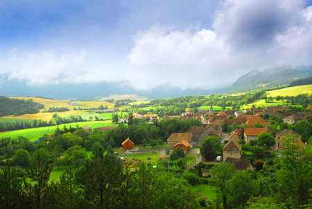 countryside landscape: Rural landscape with hills and village in eastern France Stock Photo