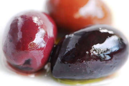 kalamata: Macro image of greek kalamata olives and olive oil Stock Photo