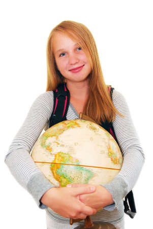 preteen girl: Young smiling school girl with a backback and a globe isolated on white background