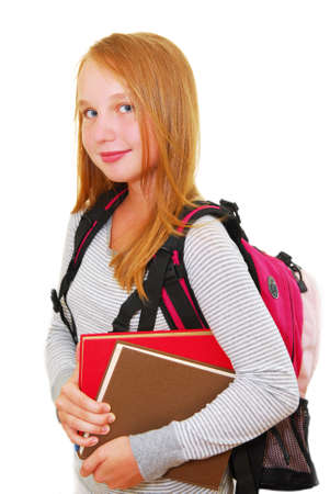 Young smiling school girl with backback and books isolated on white background Stock Photo - 1364616