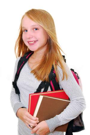 笑みを浮かべて学校少女 backback と白い背景で隔離の書籍
