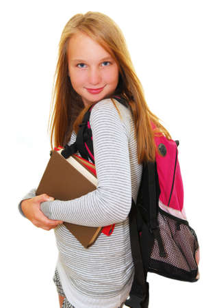 preteen girl: Young smiling school girl with backpack and books isolated on white background Stock Photo