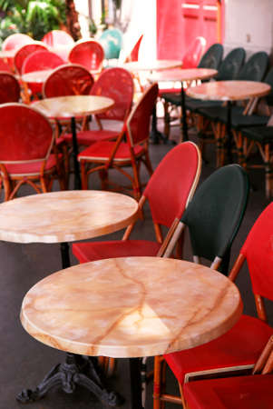 Colorful tables and chairs in sidewalk cafe. Paris, France. photo