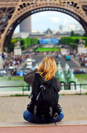 Tourist taking pictures of Eiffel tower in Paris, France. photo