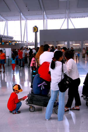 Long queue of people at modern international airport photo
